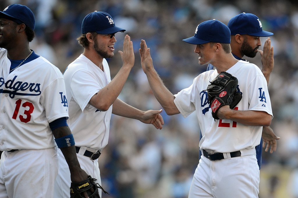 . The Dodgers\' Zack Greinke #21gets congratulated winning their game against the Rockies at Dodger Stadium in Los Angeles Saturday, July 13, 2013. The Dodgers beat the Rockies 1-0.(Hans Gutknecht/Los Angeles Daily News)