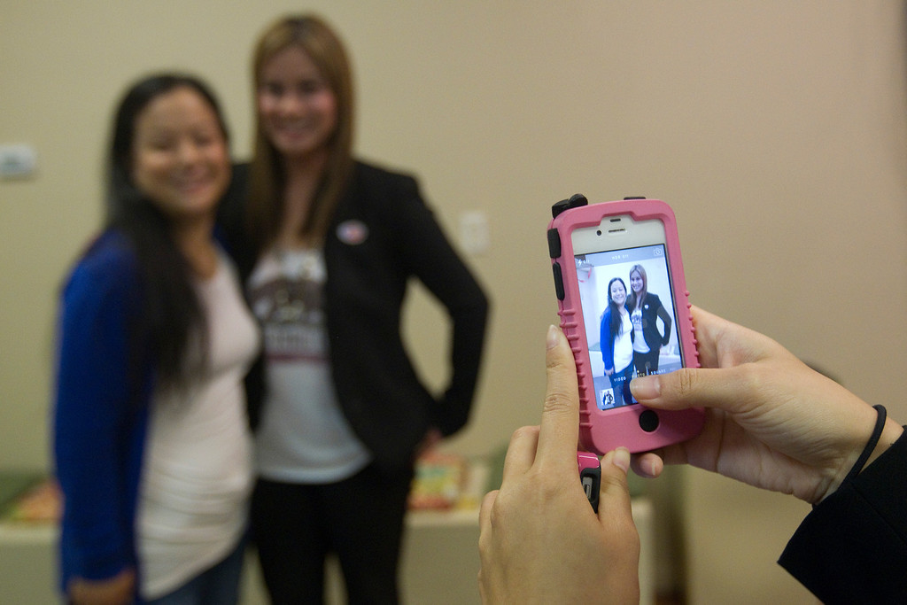 . Ling-Ling Chang poses with a supporter at her campaign headquarters in Brea, Tuesday, June 3, 2014. (Photo by Robert Huskey)