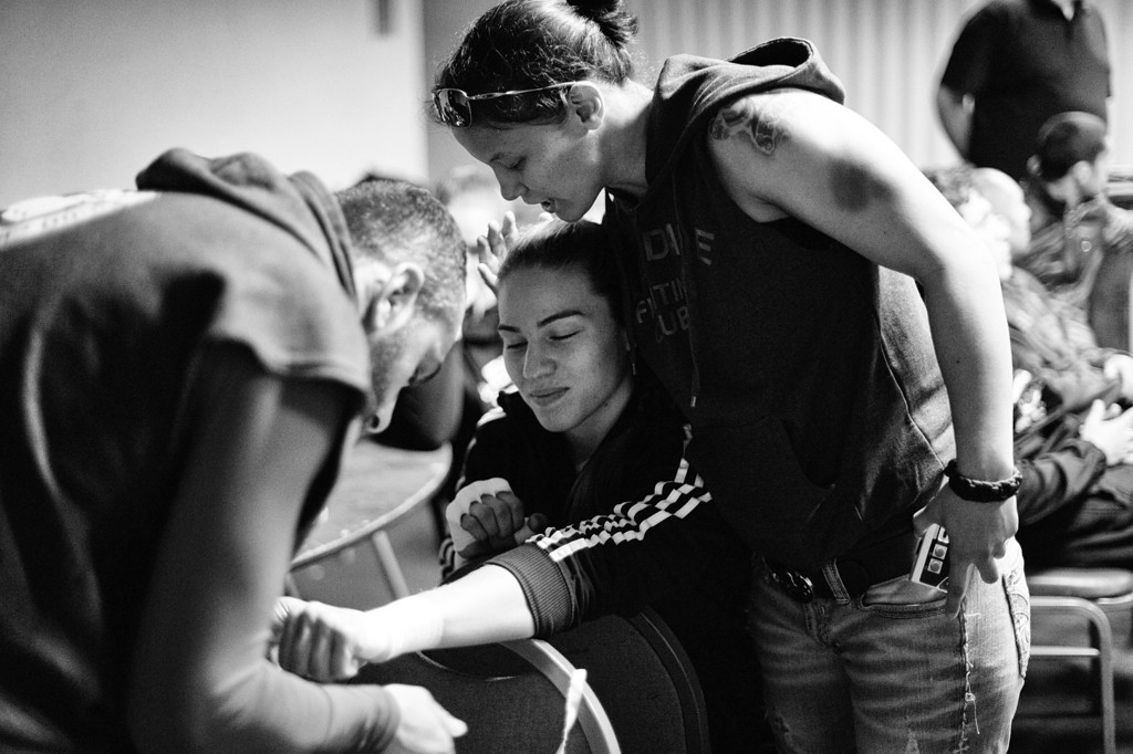 . Coach Edmond Tarverdyan wraps Marina Shafir\'s hands as friend and teammate Shayna Baszler gives her a hug and some words of encouragement before Shafir\'s professional debut at  Chaos at the Casino 4 at Hollywood Park Casino in Inglewood, CA. (Photo by Hans Gutknecht/Los Angeles Daily News)
