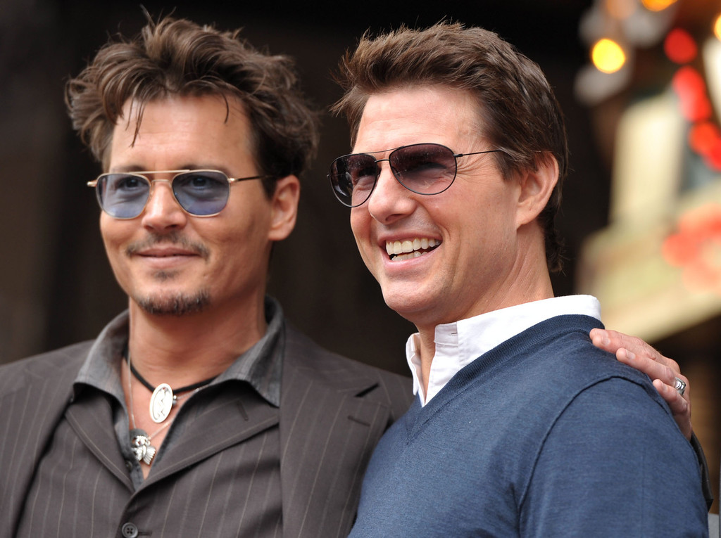 . Actors Johnny Depp, left, and Tom Cruise appear at a ceremony honoring film producer Jerry Bruckheimer with a star on the Hollywood Walk of Fame on Monday, June 24, 2013 in Los Angeles. (Photo by John Shearer/Invision/AP)