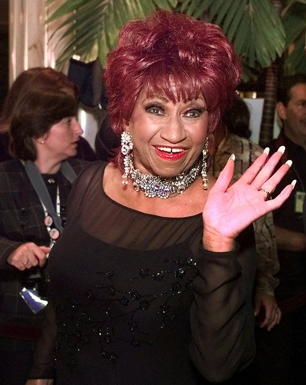 . Latin singer Celia Cruz waves to fans as she arrives at the 1999 Billboard Latin Music Awards ceremonies in the Miami Beach Fontainbleu Hotel in Miami Beach, Fla., on Thursday, April 22, 1999. (AP Photo/Amy E. Conn)