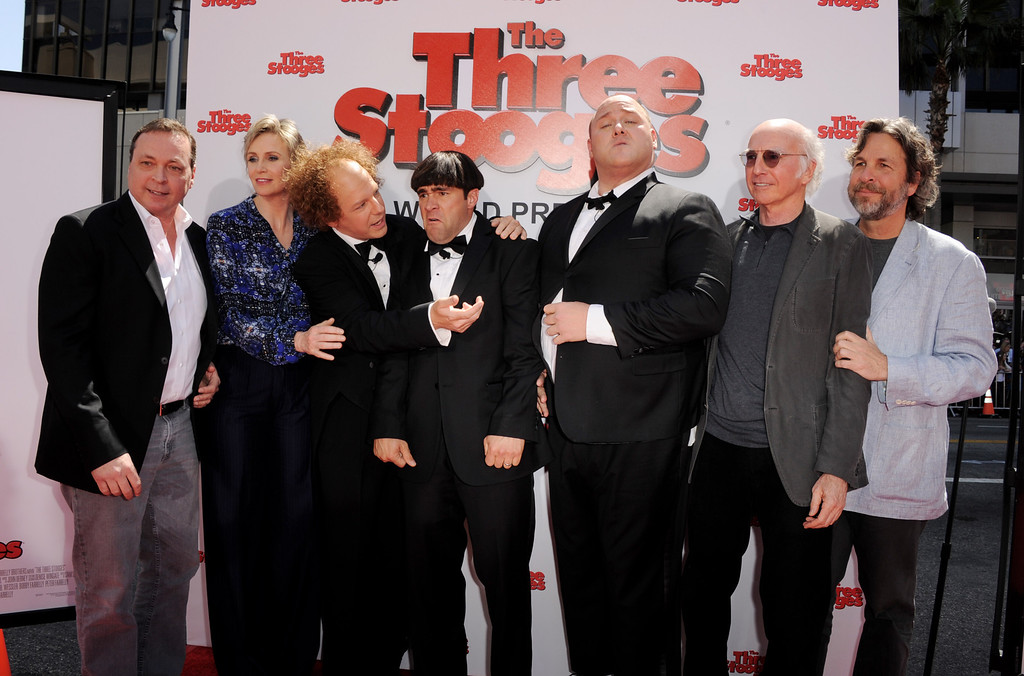 """. LOS ANGELES, CA - APRIL 07:  (L-R) Director Bobby Farrelly, actors Jane Lynch, Sean Hayes, Chris Diamontopoulos, Will Sasso, Larry David and director Peter Farrelly arrive at the premiere of Twentieth Century Fox\'s \""""The Three Stooges\"""" at the Graumans Chinese Theater on April 7, 2012 in Los Angeles, California.  (Photo by Kevin Winter/Getty Images)"""
