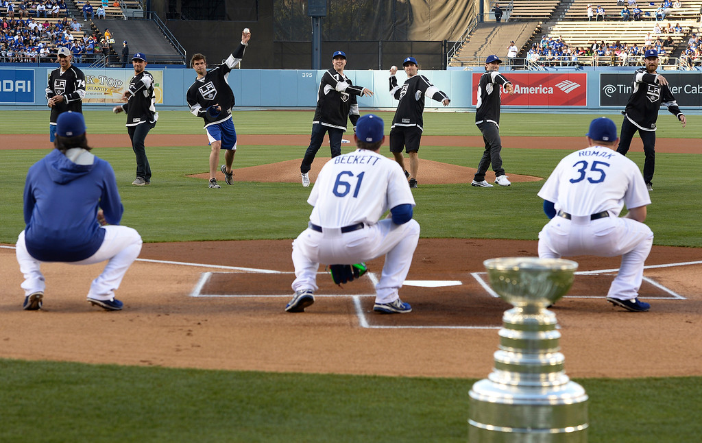 . Members of the Los Angeles Kings throw out the first pitch. Members of the Los Angeles Kings brought the Stanley Cup to Dodger Stadium for photographs before the Dodgers played the Colorado Rockies.  Los Angeles, CA. 6/18/2014(Photo by John McCoy Daily News)