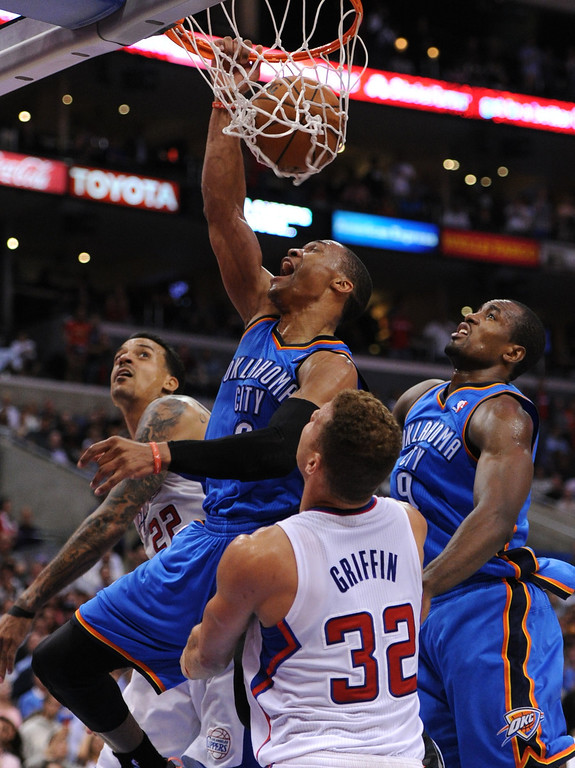 . Thunder#0 Russell Westbrook dunks over Clippers#32 Blake Griffin in the 4th quarter. The Oklahoma City Thunder defeated the Clippers 107-101 in a regular season game at Staples Center in Los Angeles, CA. 4/9/2014(Photo by John McCoy / Los Angeles Daily News)