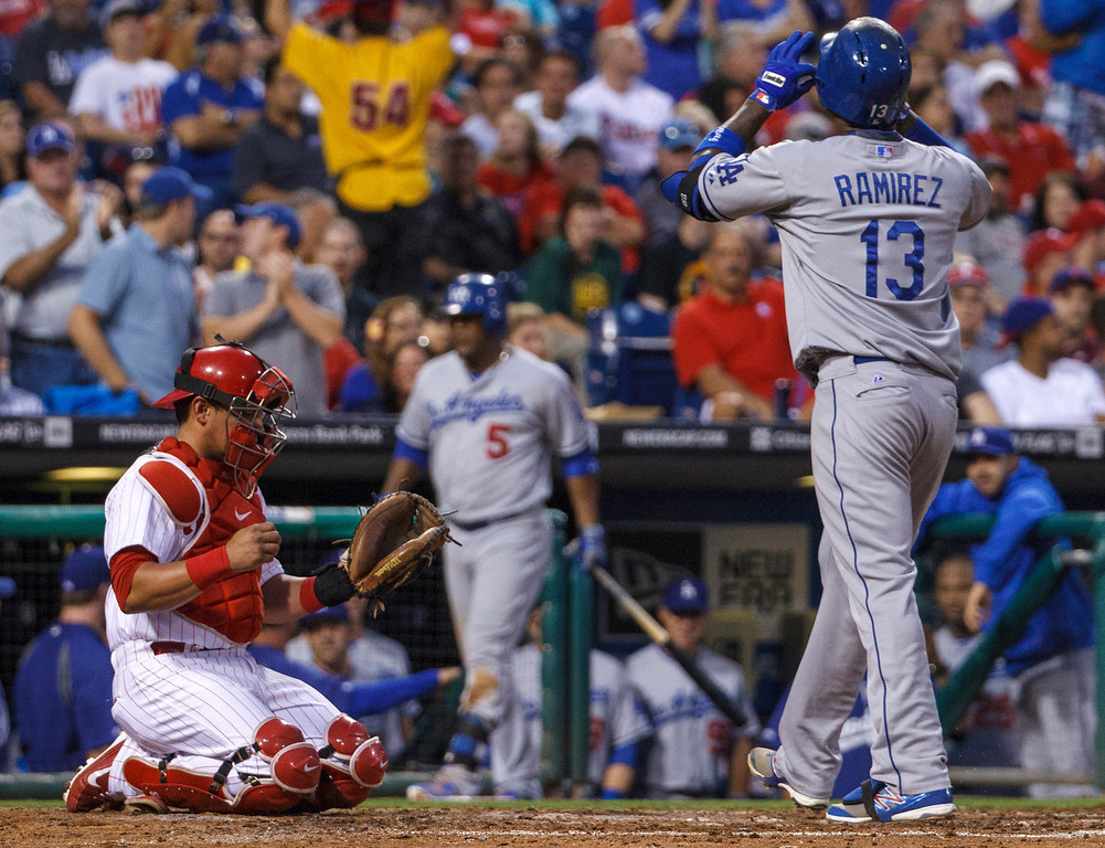 . Los Angeles Dodgers\' Hanley Ramirez reacts to his two-run home run, in front of Philadelphia Phillies catcher Carlos Ruiz during the fourth inning of a baseball game, Friday, Aug. 16, 2013, in Philadelphia. (AP Photo/Christopher Szagola)
