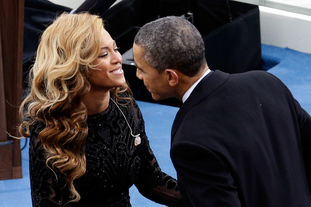 . U.S. President Barack Obama greets singer Beyonce after she performed the National Anthem during the public ceremonial inauguration on the West Front of the U.S. Capitol January 21, 2013 in Washington, DC. Barack Obama was re-elected for a second term as President of the United States.  (Photo by Rob Carr/Getty Images)