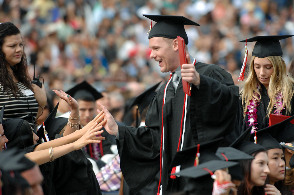 . Communication studies major Jacob Jeffrey gets high fives at the CSUN the commencement ceremony, Tuesday, May 21, 2013. (Michael Owen Baker/L.A. Daily News)