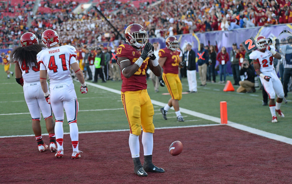 . LAS VEGAS, NV - DECEMBER 21:  Javorius Allen #37 of the USC Trojans celebrates in the end zone after scoring a touchdown against the Fresno State Bulldogs during the Royal Purple Las Vegas Bowl at Sam Boyd Stadium on December 21, 2013 in Las Vegas, Nevada. USC won 45-20.  (Photo by Ethan Miller/Getty Images)