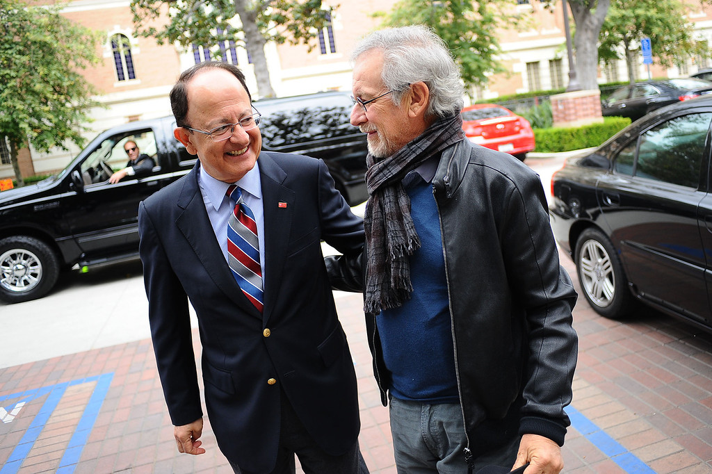 . Steven Spielberg is greeted by USC President C. L. Max Nikias on campus Friday, April 25, 2014.  They were on hand to  announce that USC will establish the Center for Advanced Genocide Research which will serve as the research and scholarship unit of the Shoah Foundation. (Andy Holzman/Los Angeles Daily News)