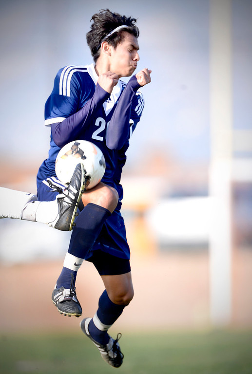 . Baldwin Park\'s Danny Vega (20) gets kicked with the ball as they defeat Northview 2-0 during Tuesday\'s game at Northview High School, February 11, 2014. Vega has made 31 goals this season. (Photo by Sarah Reingewirtz/Pasadena Star-News)