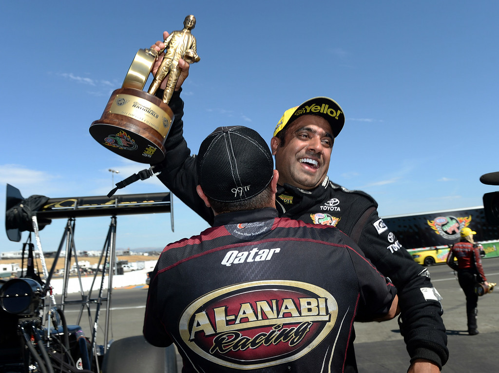 . Top Fuel winner Khalid alBalooshi celebrates with a crew member after defeating teammate Shawn Langdon, from Mira Loma, at the 27th annual NHRA Sonoma Nationals Sunday July 27, 2014. Khalid alBalooshi (Top Fuel), Courtney Force (Funny Car), Jason Line (Pro Stock) and Eddie Krawiec (Pro Stock Motorcycle) all won event titles in their respective classes Sunday July 27, 2014 at the 27th annual NHRA Sonoma Nationals. (Will Lester/Staff Photographer)
