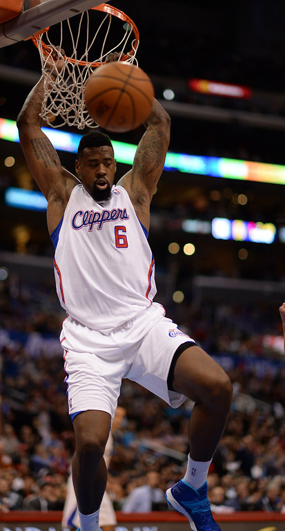 . The Clippers� DeAndre Jordan #6 dunks the ball during their game against the Raptors at the Staples Center in Los Angeles Friday, February 7, 2014. (Photo by Hans Gutknecht/Los Angeles Daily News)