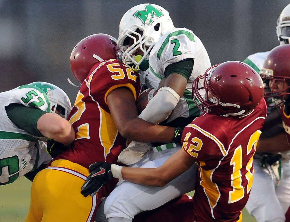 . Monrovia\'s Kurt Scoby (2) is tackled by Arcadia\'s Noah Munoz-Cas (52) and Ryan Pugh (12) in the first half of a prep football game at Arcadia High School in Arcadia, Calif. on Friday, Sept. 13, 2013.   (Photo by Keith Birmingham/Pasadena Star-News)