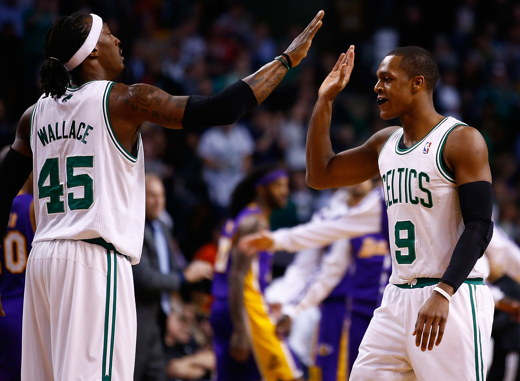 . BOSTON, MA - JANUARY 17: Rajon Rondo #9 is congratulated by teammate Gerald Wallace #45 of the Boston Celtics following a timeout in the second quarter against the Los Angeles Lakers during the game at TD Garden on January 17, 2014 in Boston, Massachusetts.   (Photo by Jared Wickerham/Getty Images)