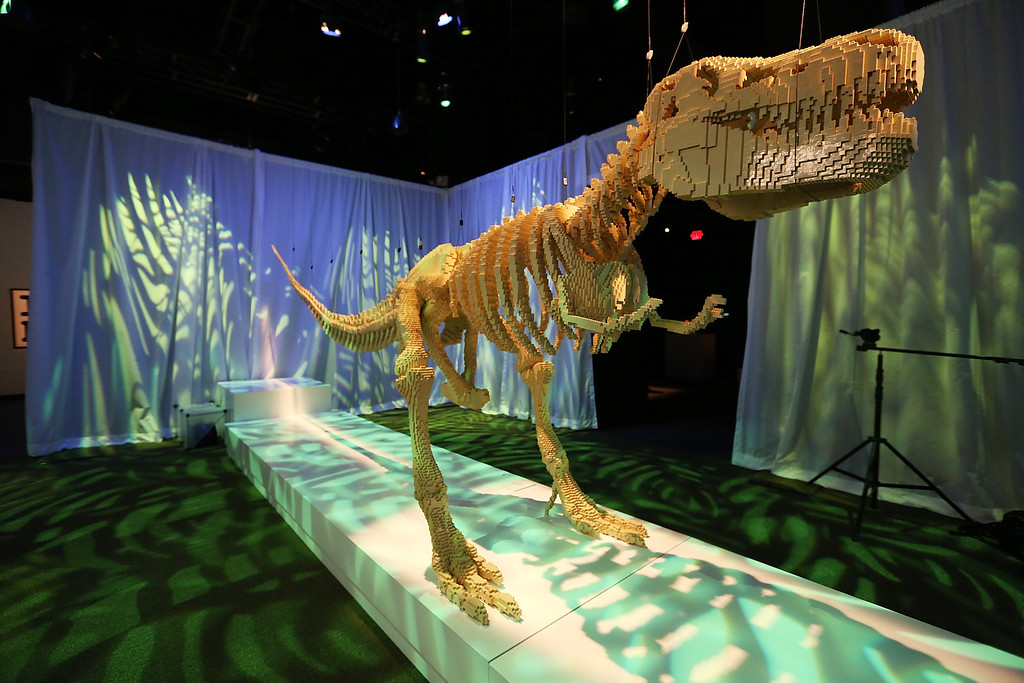 . NEW YORK, NY - JUNE 18:  A 20-foot T-Rex dinosaur skeleton, a Nathan Sawaya sculpture, is displayed in the \'Art of the Brick\' show at Discovery Times Square on June 18, 2013 in New York City.  Sawaya created the pieces entirely with LEGO toy bricks and the exhibition features over 100 works of art created from millions of the toy bricks.  (Photo by Mario Tama/Getty Images)