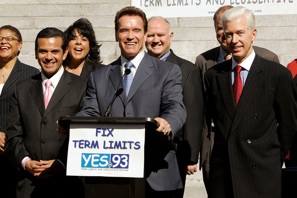 . California Gov. Arnold Schwarzenegger, center, Los Angeles mayor Antonio Villaraigosa, left, former governor Gray Davis, right, and other local leaders hold a news conference Monday, Feb. 4, 2008, in Los Angeles to urge voters to support Proposition 93, which extends legislative term limits. This represents a reversal for Schwarzenegger; he\'d previously said he would only support it if linked to redistricting reform.  (AP Photo/Ric Francis)