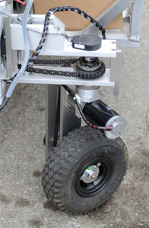 . This is a view of the front wheel on the robot. Jim Rothrock of Wunderkammer Laboratorys has built an autonomous robot for a NASA competition to develop technology that can retrieve rock samples on Mars, which would then be returned to Earth. Wunderkammer is a returning entrant in the competition\'s second year. No one won the $1.5 million prize last year. Topanga, CA 5/16/2013(John McCoy/LA Daily News)
