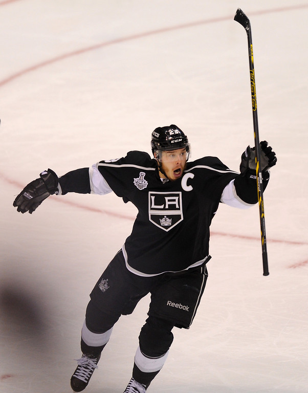 . The Kings\' Dustin Brown celebrates scoring the winning goal in the second overtime to beat the Rangers 5-4 in game two of the Stanley Cup Final, Saturday, June 7, 2014, at Staples Center. (Photo by Michael Owen Baker/Los Angeles Daily News)