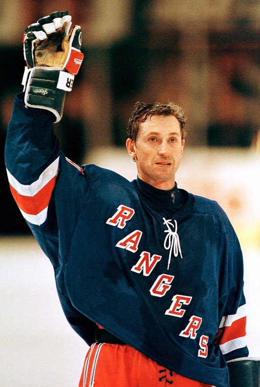 . Wayne Gretzky waves to the fans in Madison Square Garden after the last game of his career in New York, Sunday, April 18, 1999. (AP Photo/John Dunn)