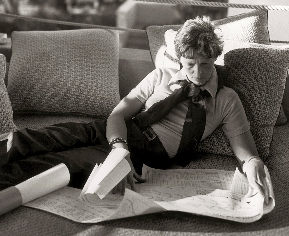 . In this January 1935 photo provided by Matson Navigation Company Archives, Amelia Earhart studies maps and charts at The Royal Hawaiian Hotel in Honolulu, Hawaii.  (AP Photo/Matson Navigation Company Archives)