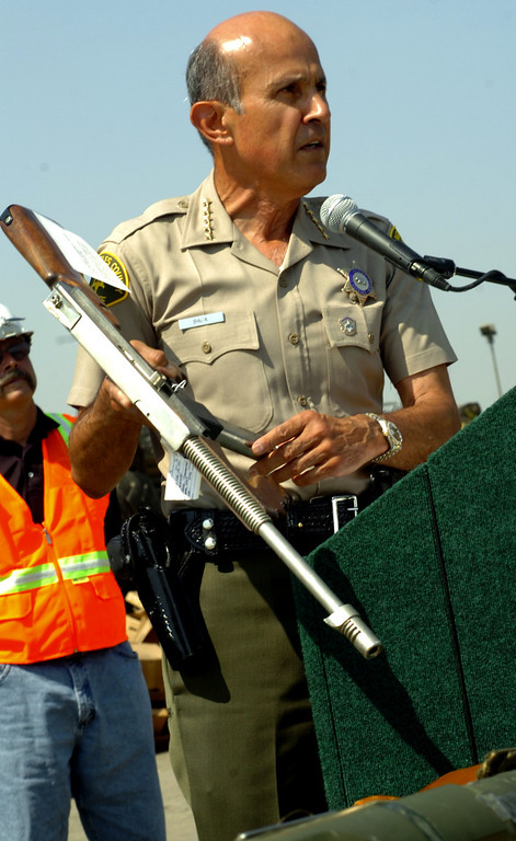 . Los Angeles County Sheriff Lee Baca displays weapon that was to be destroyed during the 15th Annual Project Isaiah weapons meltdown held at Tamco Steel in Rancho Cucamonga July 15, 2008.