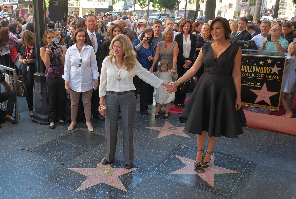 . Actress Mariska Hargitay (R) stands on her star while her sister Tina Hargitay stands on the star of their mother Jayne Mansfield on November 8, 2013 during a ceremony honoring Mariska Hargitay with the star on Hollywood Walk of Fame in Hollywood, California.               (JOE KLAMAR/AFP/Getty Images)