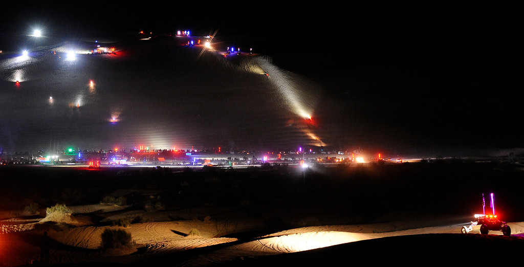 . Thousands of off-roaders with their sand rails, bikes and quads light up the night at the famous sand dune Olsmobile Hill late Friday night November 29. Over 150,000 plus come out to sand dunes of Glamis in the Imperial Dunes county of southern California for the annual Thanksgiving Weekend gathering.    REUTERS/Gene Blevins  (UNITEDSTATES)