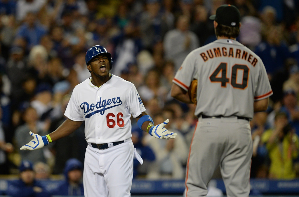 . The Dodgers Yasiel Puig #66 and Giants pitcher Madison Bumgarner #40 exchange words after Puig hit a solo home run in the 6th inning during their game at Dodger Stadium Friday, May 9, 2014. (Photo by Hans Gutknecht/Los Angeles Daily News)