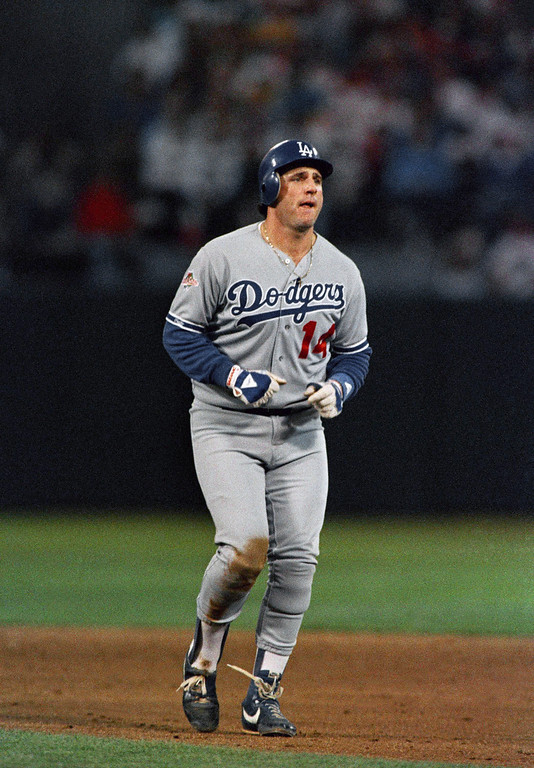 . Los Angeles Dodgers catcher Mike Scioscia limps off the field in the fourth inning after twisting his right knee while being caught stealing second, Oct. 19, 1988, Oakland, Calif. Despite being crippled by injuries the Dodgers won the game 4-3 and lead the World Series against the Oakland As 3-1. (AP Photo/Rusty Kennedy)