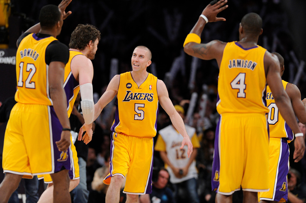 . Lakers #5 Steve Blake is congratulated for a go-ahead 3 pointer late in the 4th quarter. The Lakers defeated the Houston Rockets in overtime 99-95 in the final home game of the year at Staples Center in Los Angeles, CA 4/17/2013 (John McCoy/Los Angeles Daily News