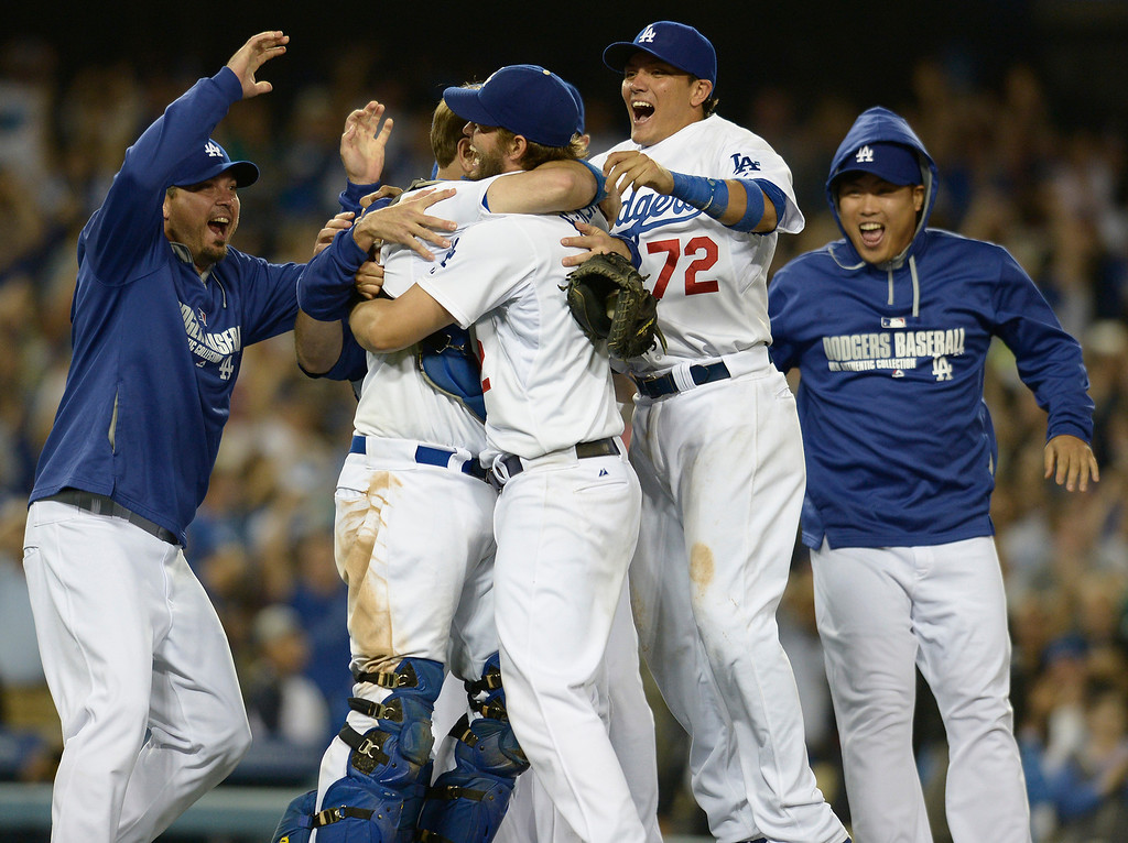 . Celebration on the diamond at Dodger Stadium after Clayton Kershaw threw a no hitter. The Dodgers defeated the Colorado Rockies 8-0 at Dodger Stadium in Los Angeles, CA. 6/18/2014(Photo by John McCoy Daily News)