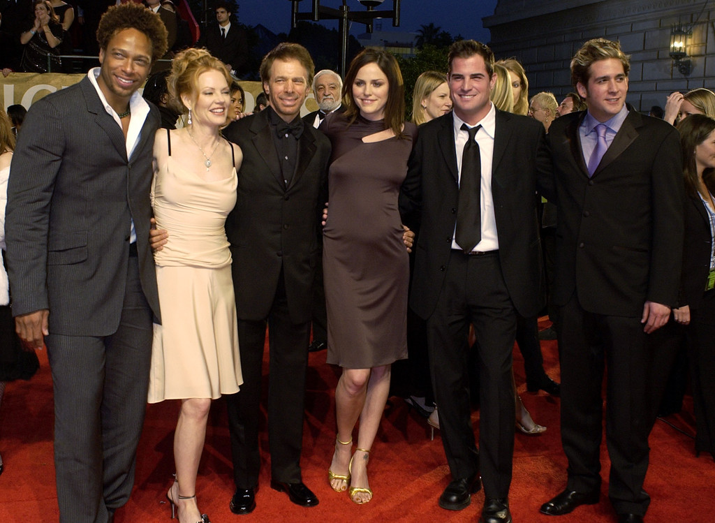 """. The cast of the television show \""""C.S.I.:Crime Scene Investigators,\""""  Gary Dourdan, left, Marg Helgenberger, executive producer Jerry Bruckheimer, Jorja Fox, George Eads, and Eric Szmanda arrive at the 30th Annual People\'s Choice Awards Sunday, Jan. 11, 2004, in Pasadena, Calif. (AP Photo/Reed Saxon)"""