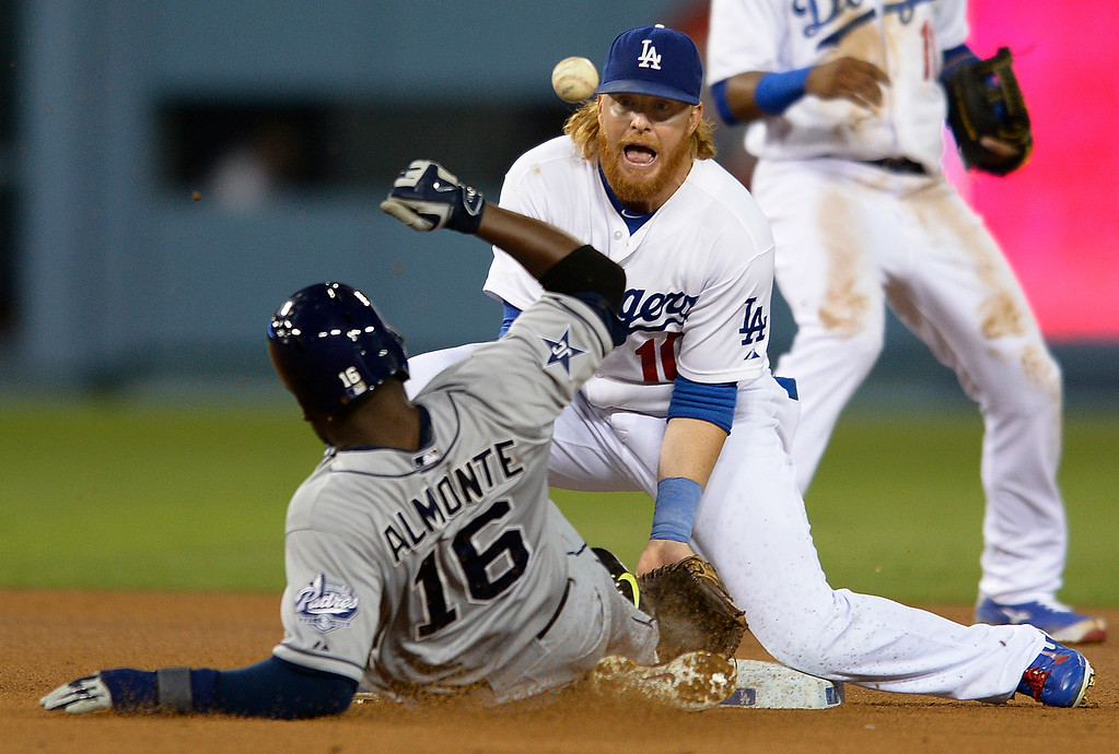 . Padres Abraham Almonte was hit in the back with the ball, while Justin Turner tried to make the play at 2nd base in the 3rd inning. Almonte would return to first base, but then get caught stealing later in the inning. The Dodgers played the San Diego Padres at Dodger Stadium. Los Angeles, CA. 8/19/2014(Photo by John McCoy Daily News)
