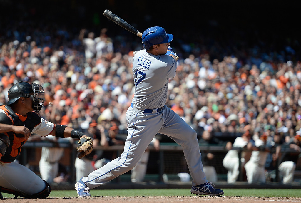 . A.J. Ellis #17 of the Los Angeles Dodgers hits a bases loaded double, scoring all three runs in the ninth inning against the San Francisco Giants at AT&T Park on July 7, 2013 in San Francisco, California. The Dodgers won the game 4-1. (Photo by Thearon W. Henderson/Getty Images)