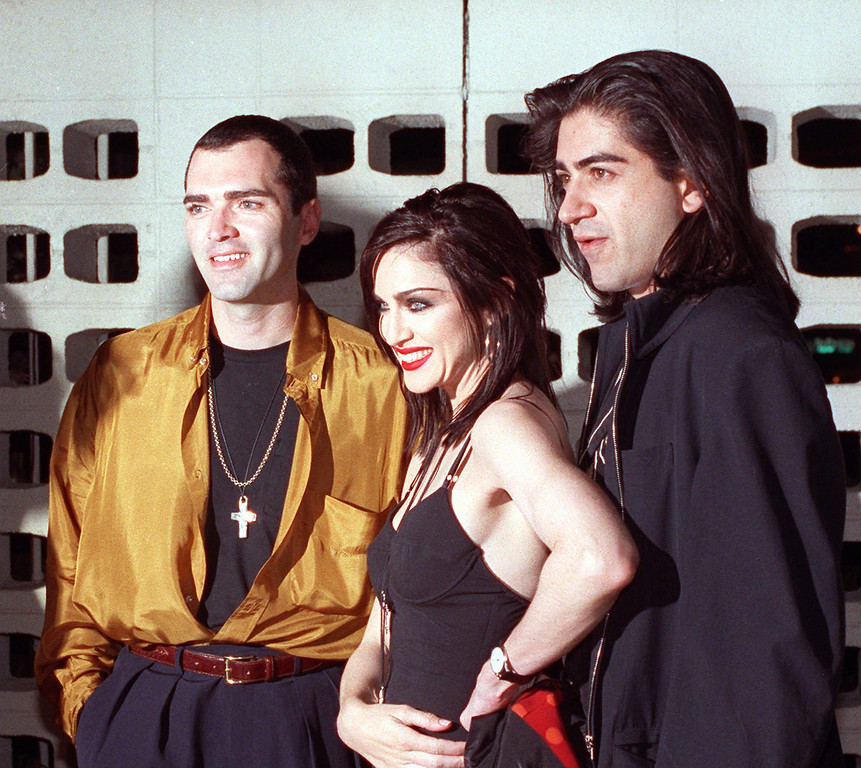 ". Madonna poses with her brother, Christopher Ciccone, left, and director Alek Keskishian following the premiere showing of Madonna\'s newest film, ""Truth or Dare,\"" in the Hollywood section of Los Angeles on May 7, 1991.  The film, directed by Keskishian, is an intimate look at Madonna during her Blond Ambition tour.  Her brother was the art director of the tour. (AP Photo/Julie Markes)"