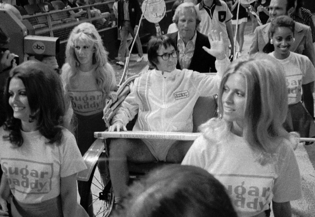 ". Bobby Riggs rides in a carriage pulled by women in his grand entrance to the Astrodome in Houston, Tx., for his $100,000 winner-take-all ""Battle of the Sexes\"" match against Billie Jean King, Sept. 21, 1973. (AP Photo)"