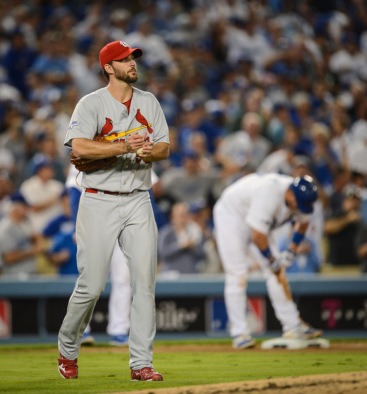 . Cardinals\' Adam Wainwright pauses after allowing Dodgers\' A.J. Ellis a triple during game action in NLCS game 3 at Dodger stadium Monday, October 14, 2013 ( Photo by Hans Gutknecht/Los Angeles Daily News )