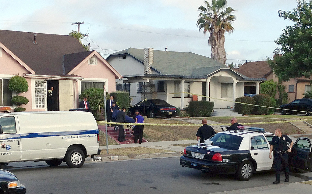 """. Los Angeles County coroner\'s officials remove the body of April Jace, the wife of actor Michael Jace, from the couple\'s home in the Hyde Park area of Los Angeles Tuesday morning, May 20, 2014. Michael Jace, who played a police officer on the hit TV show \""""The Shield,\"""" was arrested Tuesday on suspicion of shooting his wife to death, authorities said. (AP Photo/Dwight Flowers)"""