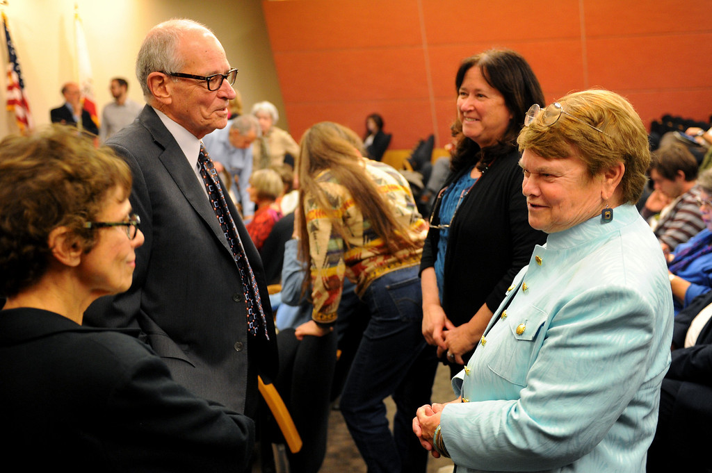 . Warren Olney, back-left, and candidate Sheila Kuehl, right, greet folks before the 3rd District Board of Supervisors debate, Thursday, March 20, 2014, at UCLA�s California NanoSystems Institute Auditorium. (Photo by Michael Owen Baker/L.A. Daily News)