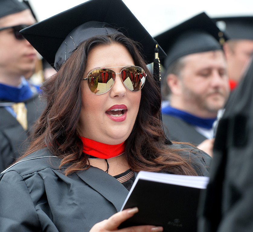 ". Julie Maxham sings the hymn ""Great is Thy Faithfulness\""  during the Commencement Ceremony at Biola University in La Mirada on Friday May 23, 2014. Kay Warren, International speaker and author, gives the commencement address. (Photo by Keith Durflinger/Whittier Daily News)"