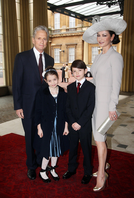 . Hollywood actress Catherine Zeta Jones, right, and her husband Michael Douglas, with their children Dylan and Carys, arrive at Buckingham Palace in London where Catherine Zeta Jones will be invested with the royal award as a CBE (Commander of the Order of the British Empire) by the Prince of Wales,  Thursday Feb. 24, 2011.  The Welsh-born actress who became an Oscar-winning star will receive the honour for her services to the film industry and to charity. (AP Photo / Lewis Whyld)