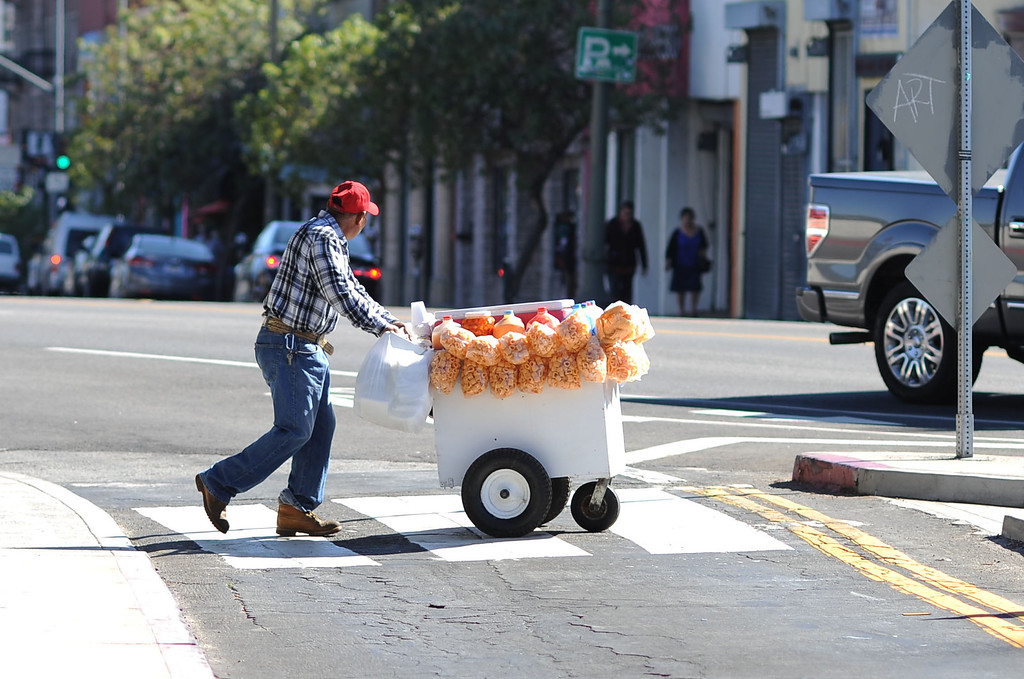 . A street vendor pushes his cart in Los Angeles, CA November 6, 2013.   Street vendors descended on City Hall Wednesday in support of a measure that would legalize street vending in the city.(Andy Holzman/Los Angeles Daily News)