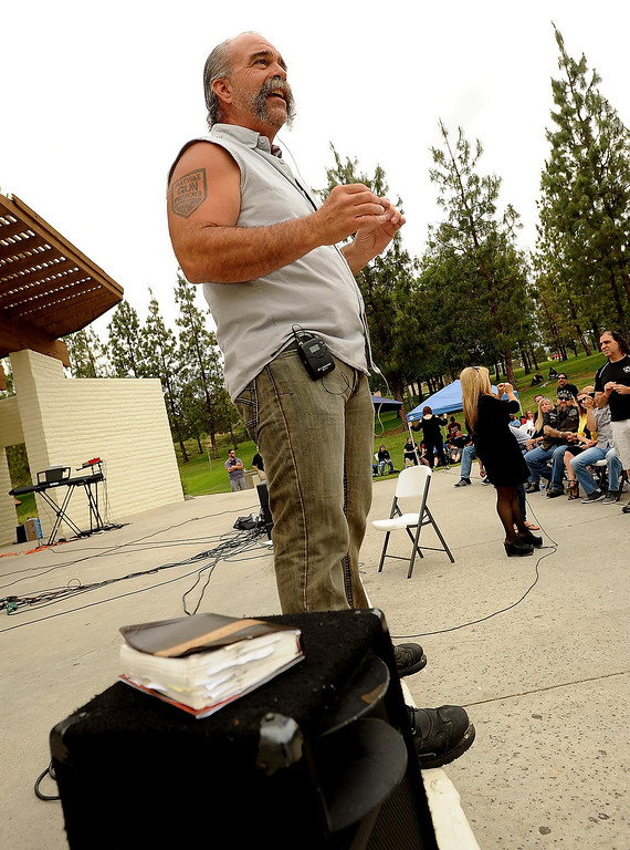 """. �Violence does not glorify God,\"""" said Sam Childers to a crowd during the Lifepoint Church\'s Picnic at Red Hill Community Park in Rancho Cucamonga May 5, 2013. \""""The God that we serve is not a God of violence.\""""  GABRIEL LUIS ACOSTA/STAFF PHOTOGRAPHER."""
