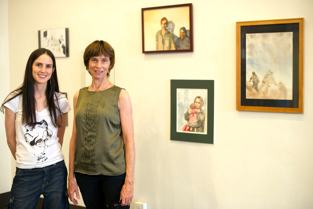 . Artists Lara Salmon and her mother Niki Salmon with art that will be sold raise money to help Syrian refugees. They\'ve created paintings of refugees locally and abroad as some related to their Middle East travels. They will be selling originals and prints of the art at the Louis Jane Studio in Old Pasadena, 93 E. Union Street in Legge Alley, starting Sunday from 4 to 9 p.m. (Hans Gutknecht/Los Angeles Daily News)