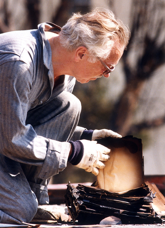 . Frank Thomas of Malibu sorts out papers that were singed or burned in the fire at his house on Pas Portola.  (11/4/93)  Los Angeles Daily News file photo