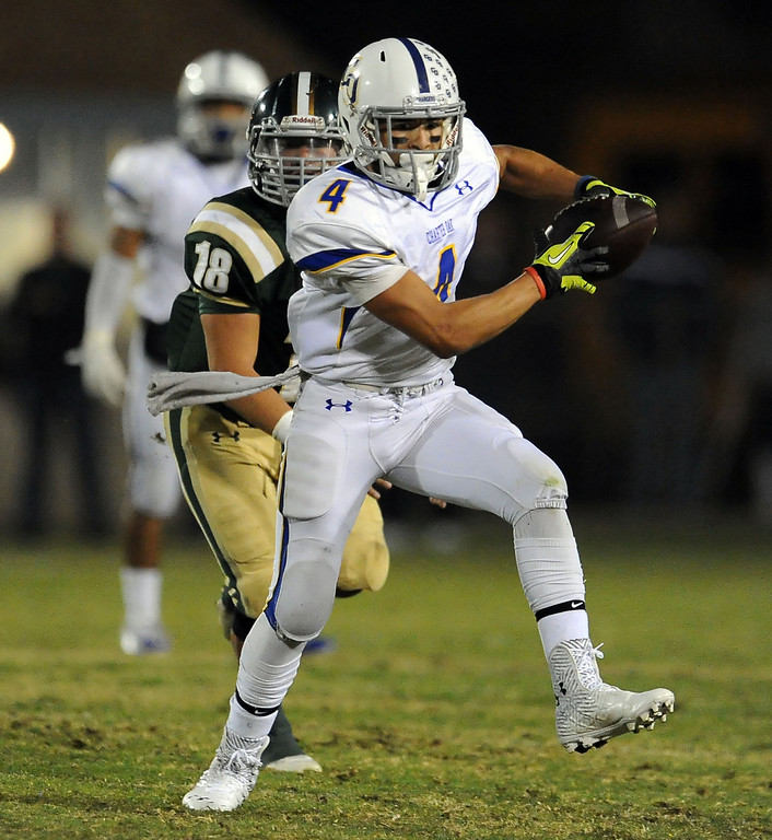 . Charter Oak\'s Donavin Washington (4) runs past South Hills\' Matthew Chavez (18) for a first down in the first half of a prep football game at Covina DIstrict Field in Covina, Calif., on Thursday, Oct. 24, 2013. 