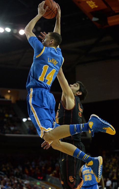 . UCLA\'s Zach LaVine (14) drives to the basket against Southern California in the first half of a PAC-12 NCAA basketball game at Galen Center in Los Angeles, Calif., on Saturday, Feb. 8, 2014. (Keith Birmingham Pasadena Star-News)