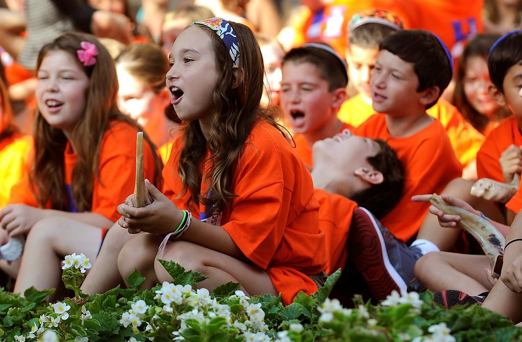 . Children at the Abraham Joshua Heschel Day School gathered to blow their shofars and sing Jewish songs for the Rosh Hashanah holiday. Northridge, CA. 8/30/2013(John McCoy/LA Daily News)