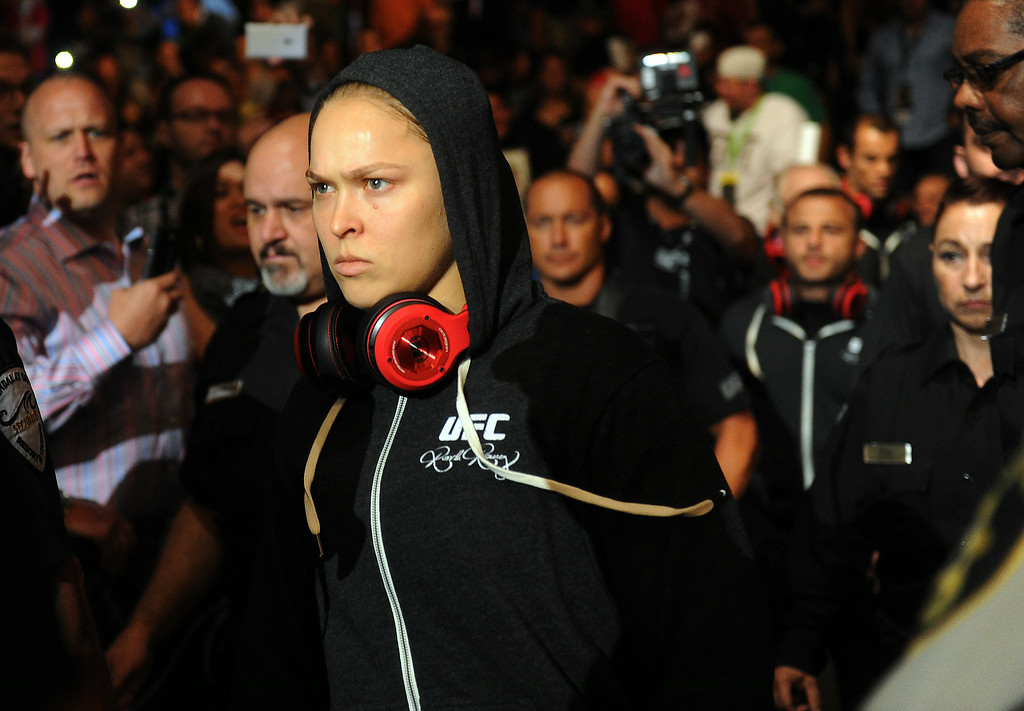 . UFC Women\'s Bantamweight Champion Ronda Rousey walks to the cage. Rousey defeated  challenger Alexis Davis 16 seconds in to the first round during UFC 175 at the Mandalay Bay Events Center July 5, 2014. (Photo by Hans Gutknecht/Los Angeles Daily News)