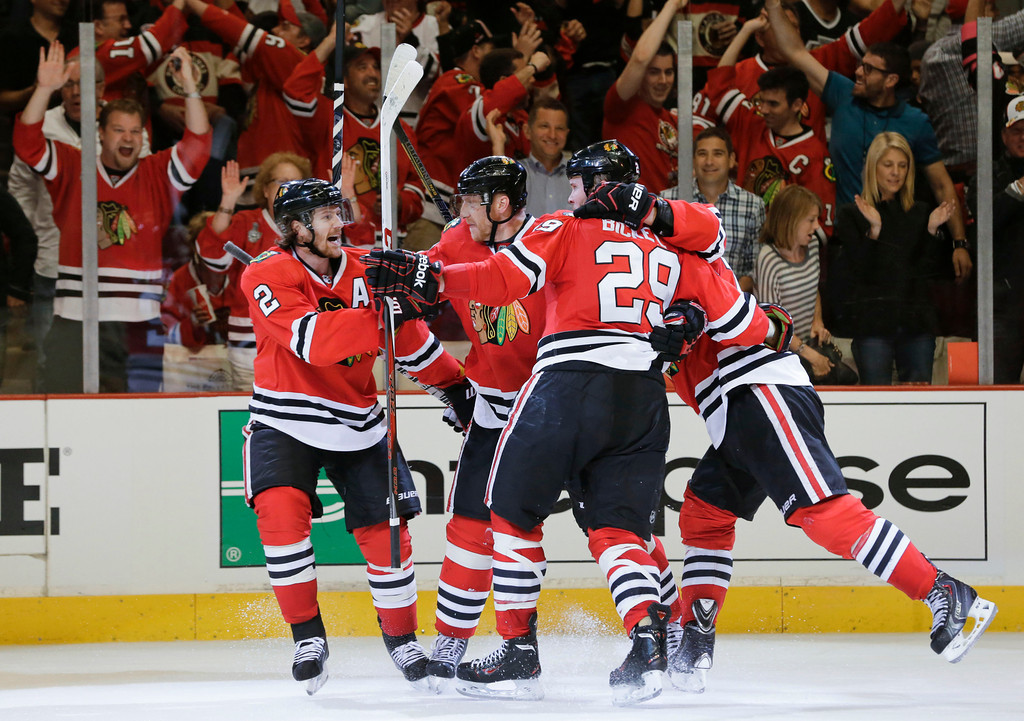 . The Chicago Blackhawks celebrate after a goal against the Los Angeles Kings during the second period of Game 1 of the NHL hockey Stanley Cup Western Conference finals, Saturday, June 1, 2013, in Chicago. (AP Photo/Nam Y. Huh)